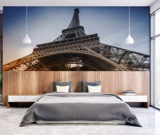 resting under the cult tower eiffel tower wallpaper mural photo wallpapers demural